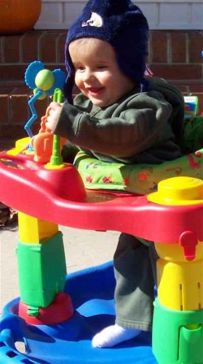 Houston playing outside in his Exer-Saucer in late January 2008.