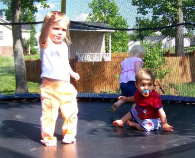Houston, Gracie & Dixie on the trampoline in May 2008.